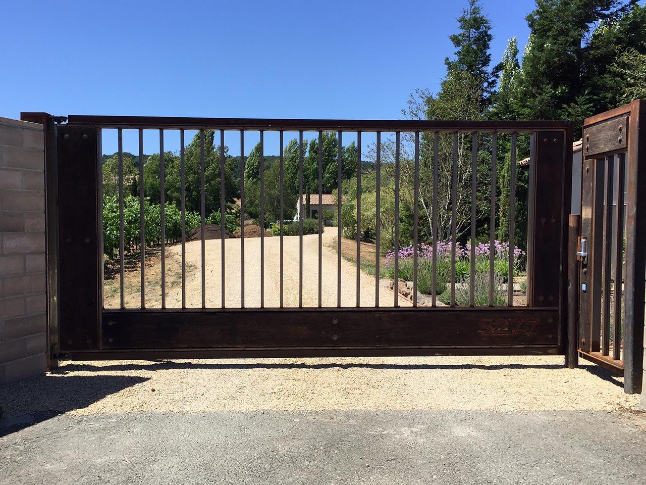 Flat top driveway gates custom wrought iron ornamental for Best driveway gates