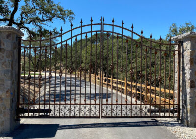 Bell Curve Bi-Parting Driveway Gate – w/ Spear Tips, Baskets, Knuckles & Bottom Scroll Work.